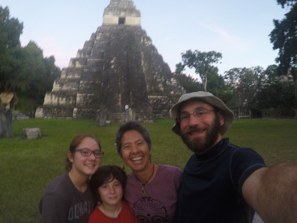 Vanamos family is all smiles for a photo in front of the Jaguar Temple, despite a long trek to the Gran Plaza at Tikal through a mosquito and heat laden jungle.