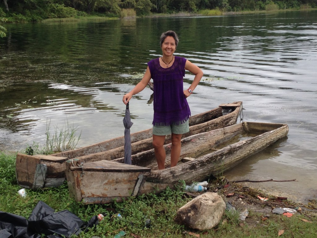 R hamming it up on Lago de Peten Itza. Most of the boats we rented were sturdier than this piece of log.