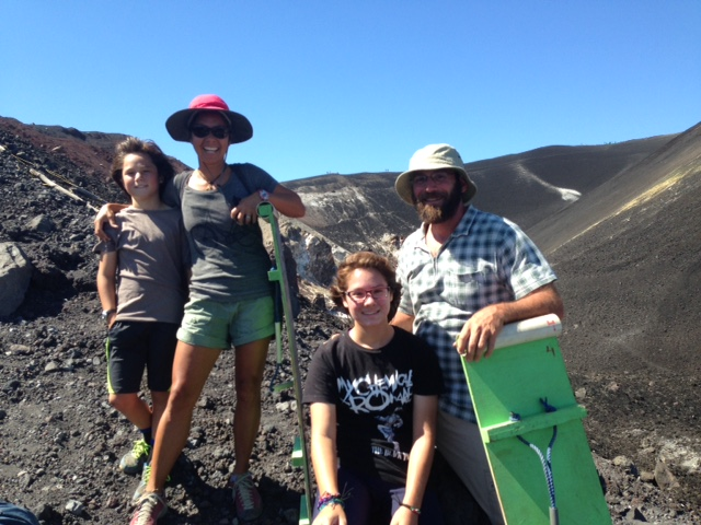 Hiking up a volcano to surf down it in celebration of R's birthday.