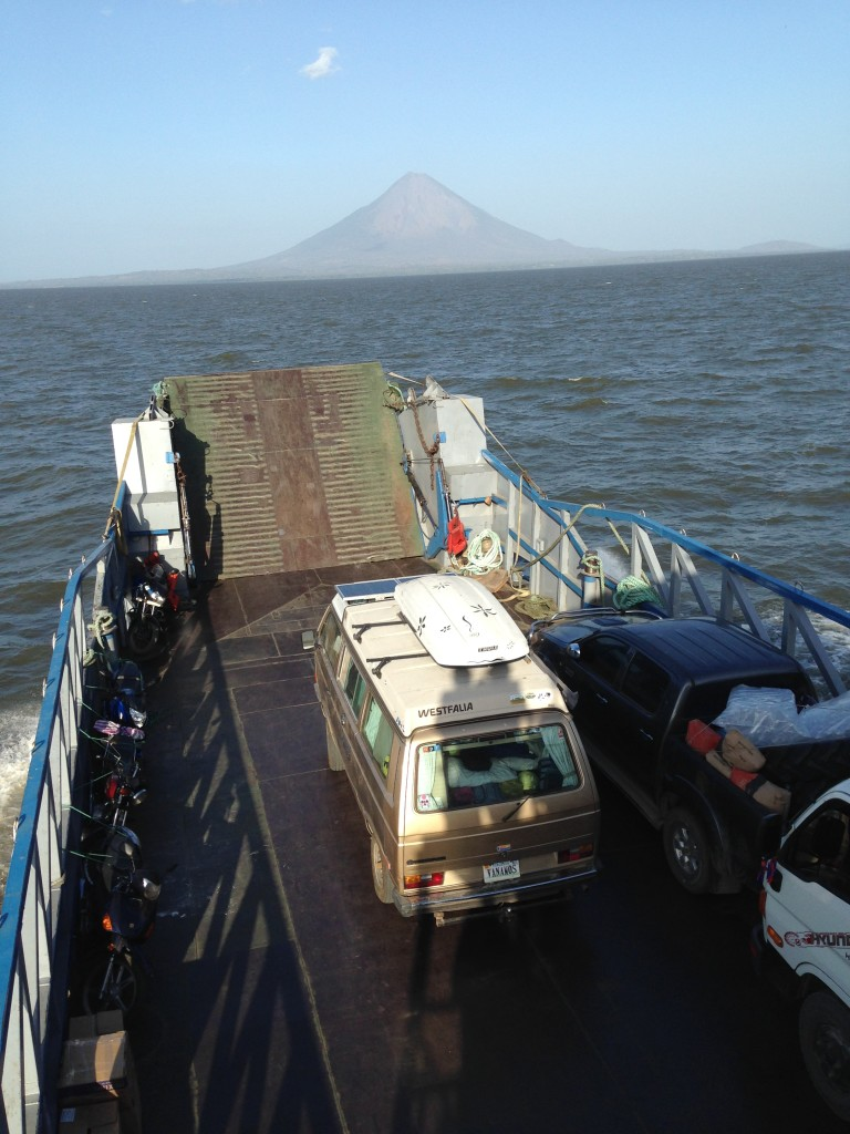 Crossing Lake Nicaragua on the way to Isla de Ometepe with Vulcan Concepcion looming in the background. The people shadows that you see on the back of Wesley are Coconut and me.