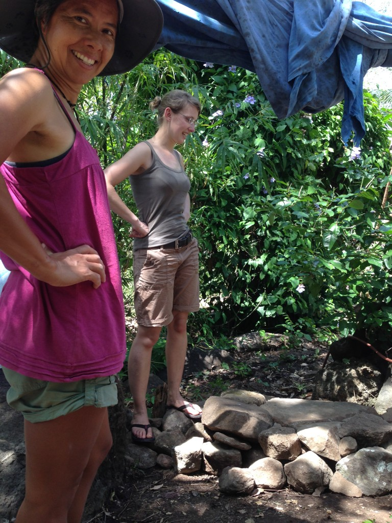 R and fellow Workaway volunteer, Imke, admire their work.  They made a floor for the open-air shower stall by laying stones gathered from around the farm.