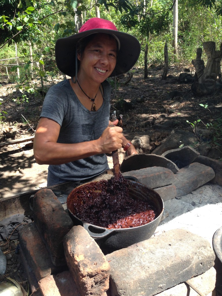 Day 4: Cooking the ground cacao with hand-grated coconut and boiled cane sugar over the wood fire.