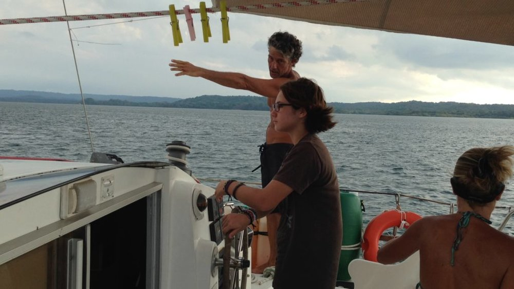 Captain Sandro directs Coconut towards the first set of locks