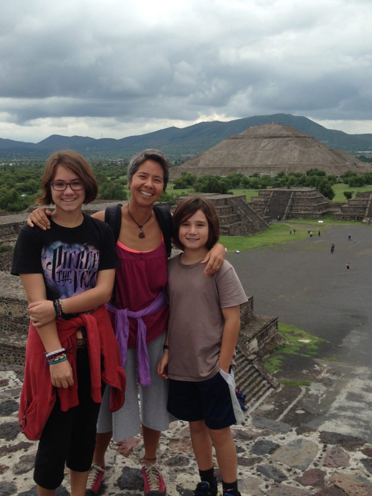 R is flanked by Coconut and J atop the Pyramid of the Moon with the massive Pyramid of the Sun poised in the background