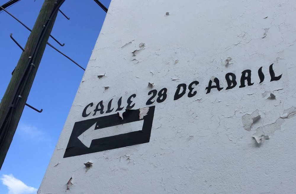 Street sign for April 28th Street in San Miguel de Allende, Mexico