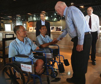 DANANG CITY, April 19, 2014 - Senator Patrick Leahy welcomes Phan Van Son (left) and Tran Cong Phuong (right), both are beneficiaries of the Leahy War Victims Funds as Senator Richard Shelby and Mr. Tim Rieser look on.