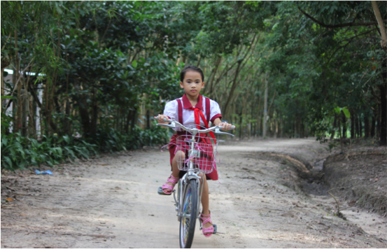 Yen Nhi, who could barely walk two years ago, now can ride a bicycle