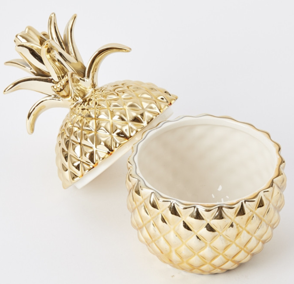 - My gold pineapple cup was from home goods and was under $15! I use my pineapple to store loose change, receipts and other pocket clutter. While I couldn't find this exact one online, I found a similar one here.