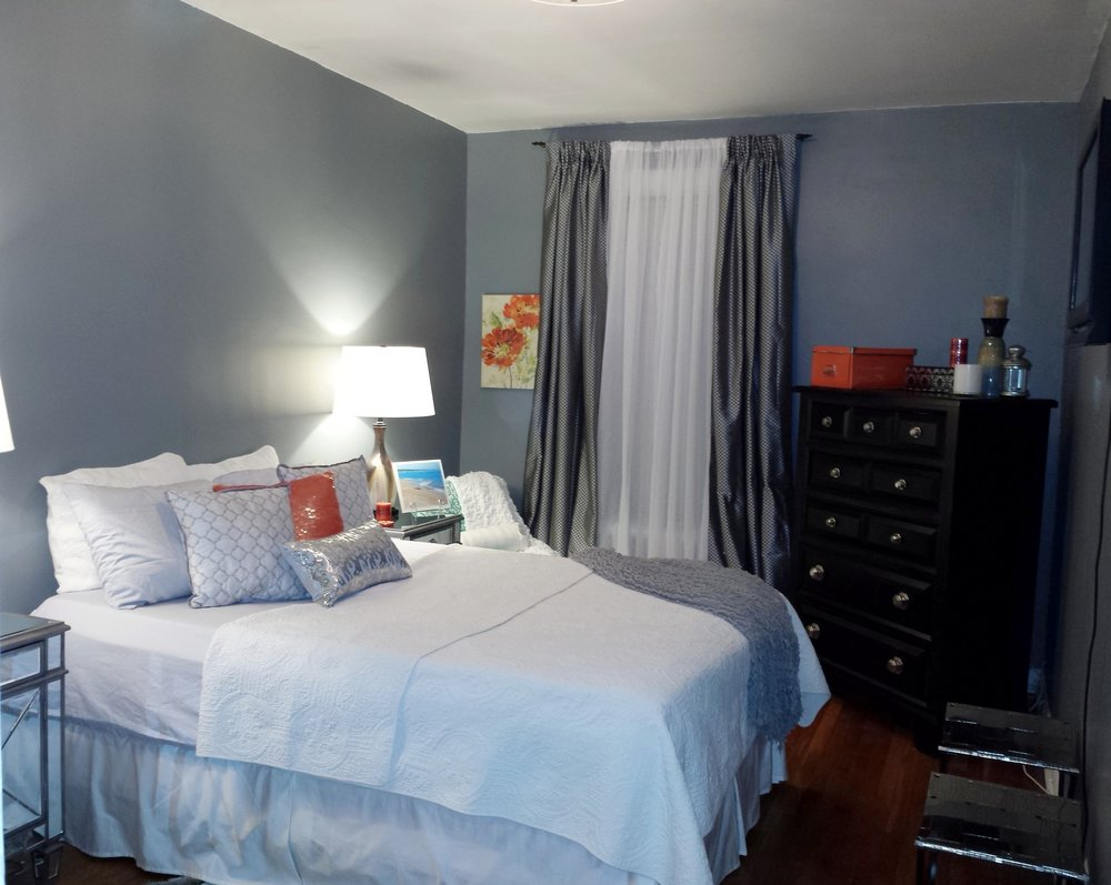 After! We redesigned this bedroom by giving it a new paint color and using the owners accessories.
