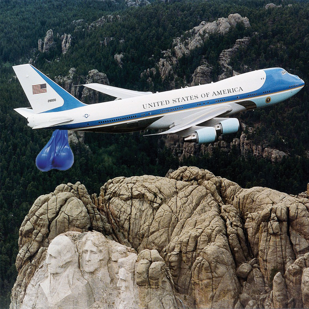 Depicted are the new Air Force One Truck Nutz hanging majestically over our beloved forefathers.