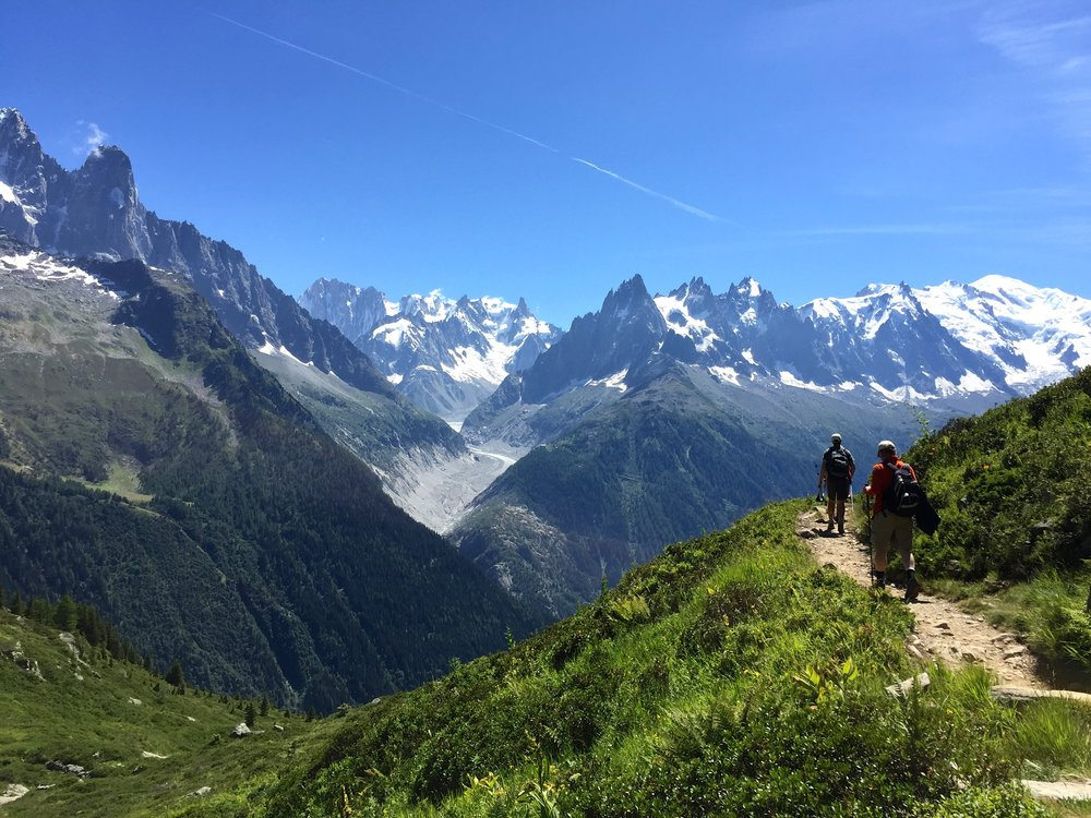 The last day on the tour, we hike back into the Chamonix Valley, you can see the Needles ahead and Mont Blanc peeking on the right.