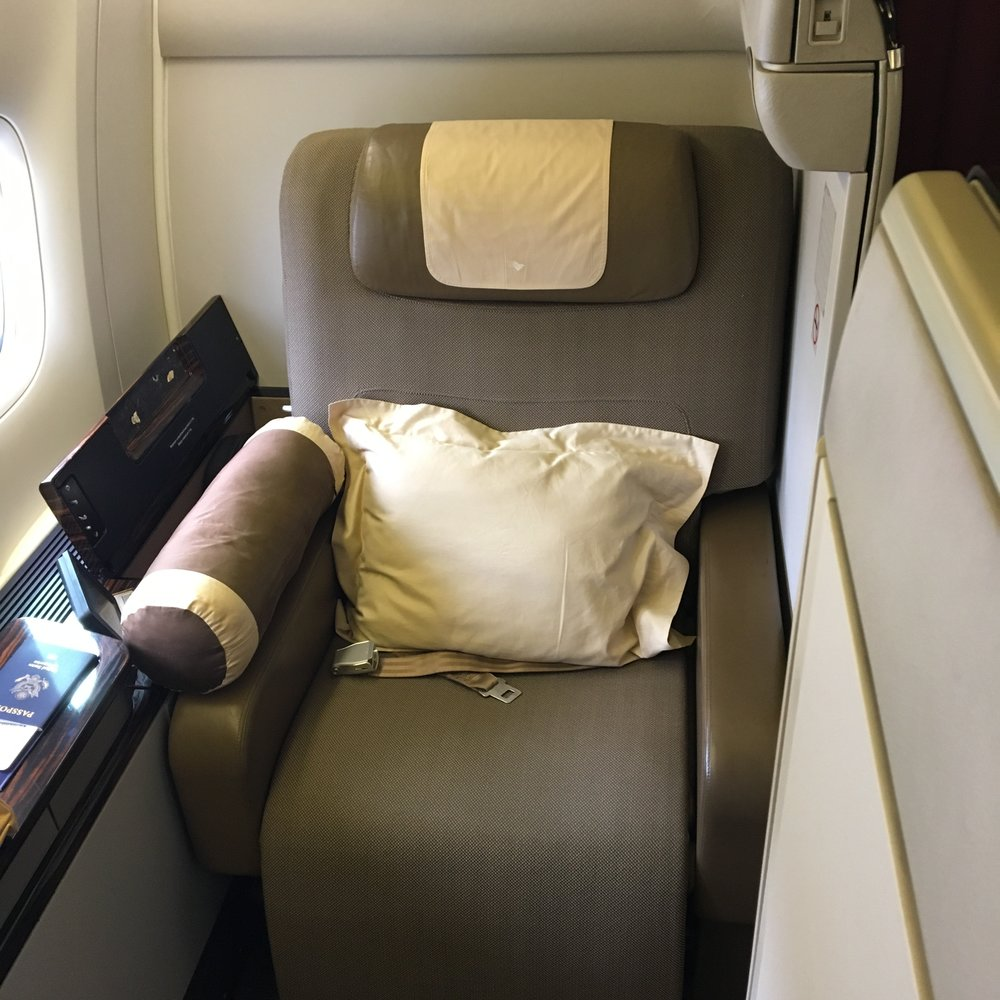 My comfy first class seat with nicer pillows than I have at home.