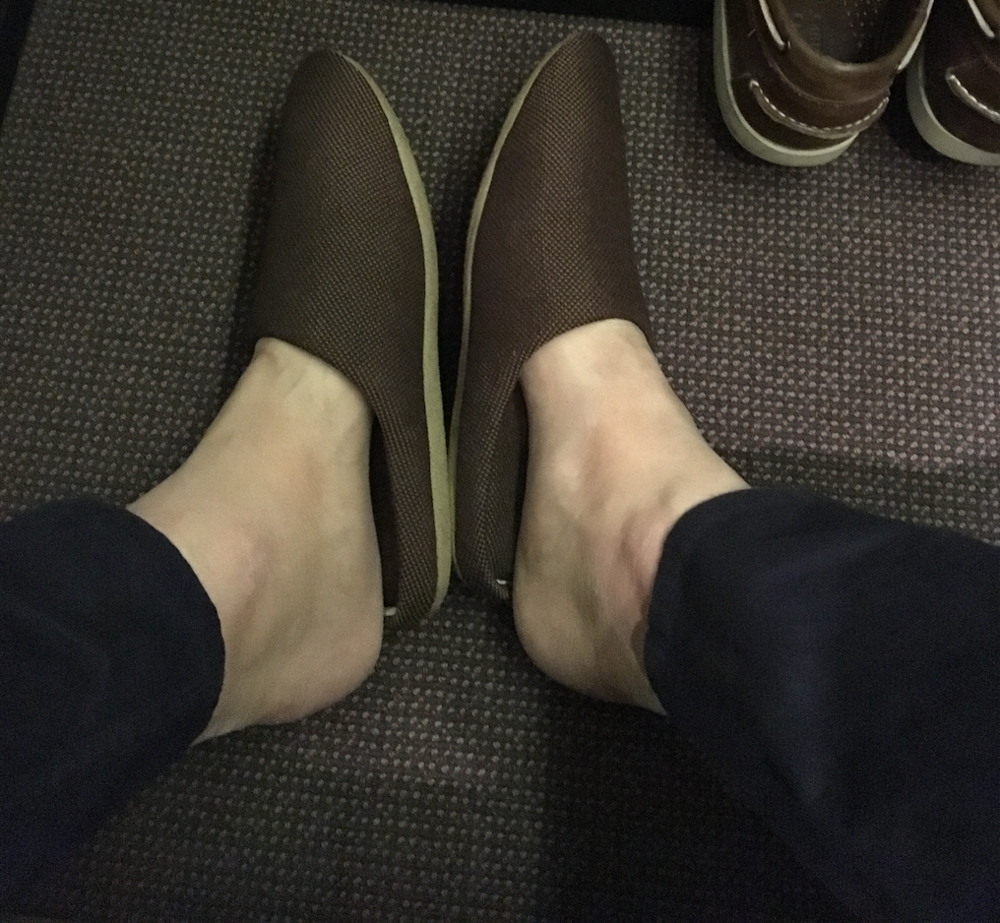 I jammed my feet into the slippers with little success.