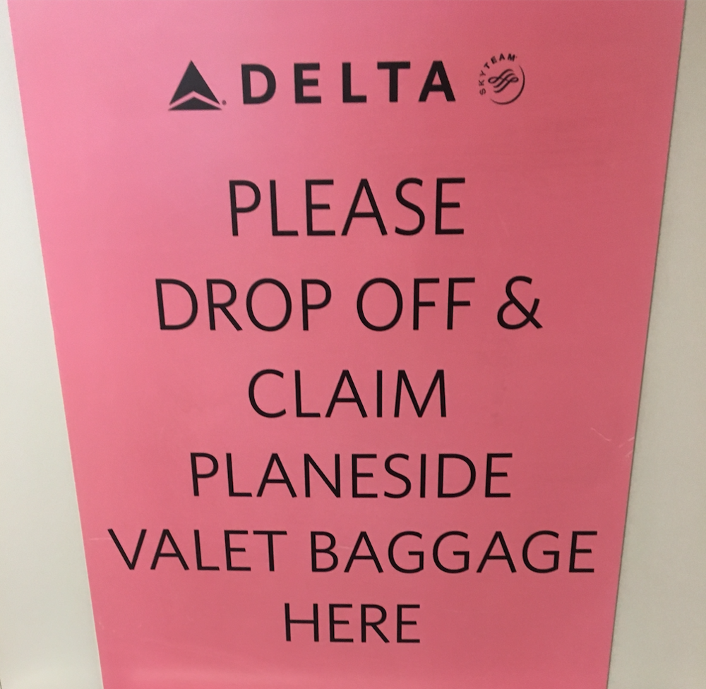 The little pink sign taunting me as I wait for my bag at JFK's Terminal 2.
