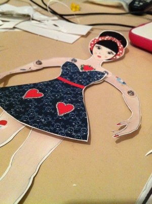 Rockabilly Paper Doll   Print her out and cut her up. You'll need to get yourself some 'brads' to be able to put her together.  NOTE: THIS FILE IS A3