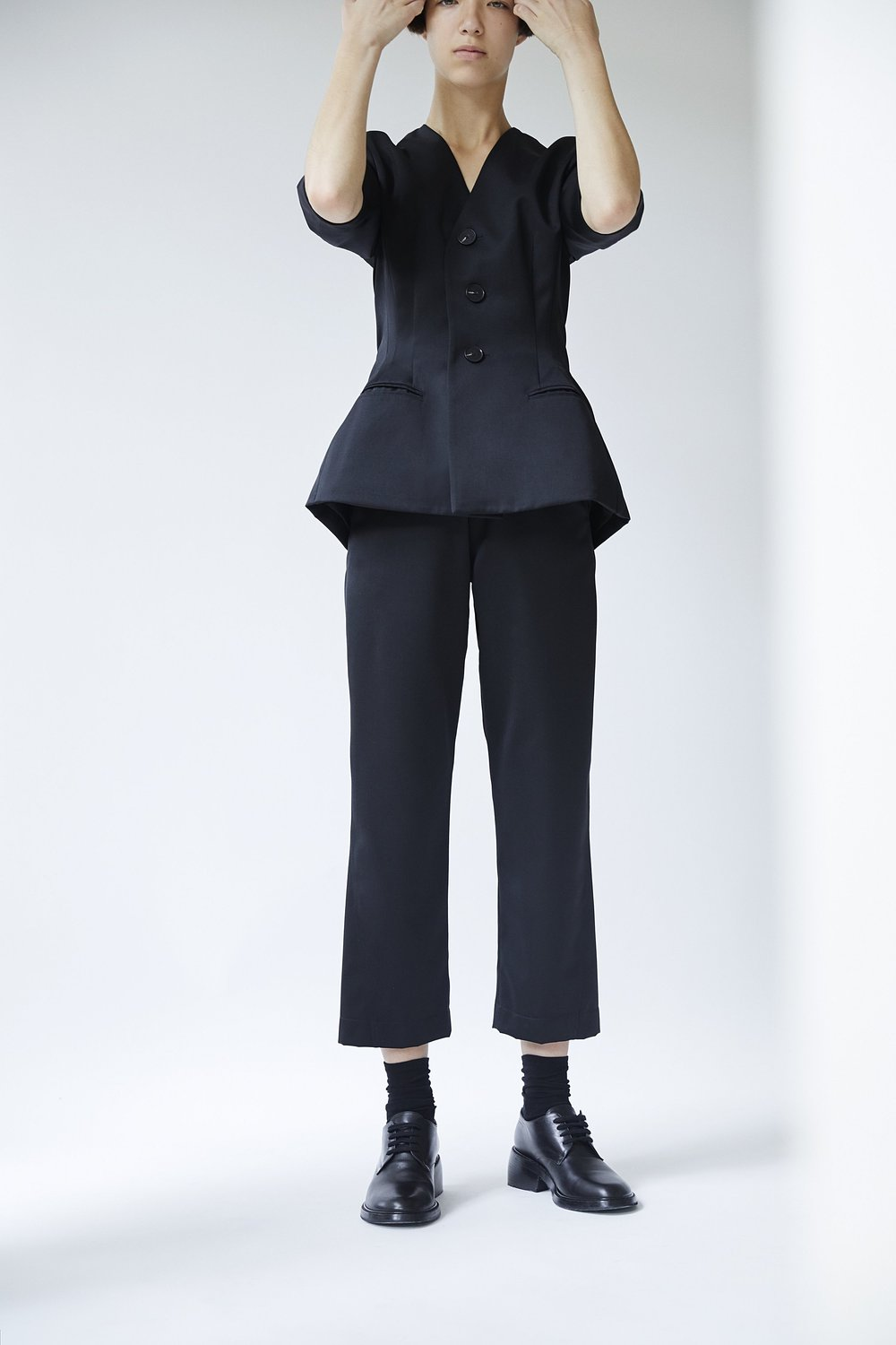 ARNE   cropped-sleeve jacket and   EVA   curved-seam trousers in BLACK