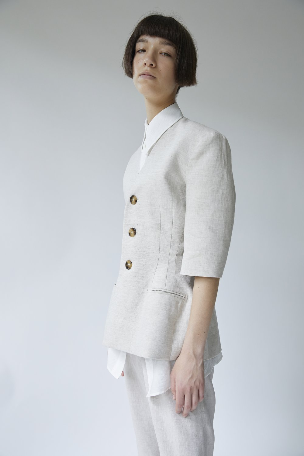 ARNE   cropped-sleeve jacket worn with ADA short-sleeve shirt in CHALK