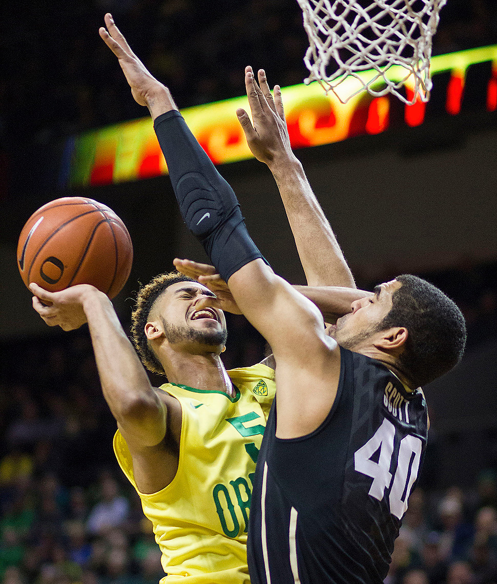 Duck Tyler Dorsey (#5)goes up for a lay up against Colorado Buffalo Josh Scott (#40). The Oregon Ducks defeated the Colorado Buffaloes 76-56.