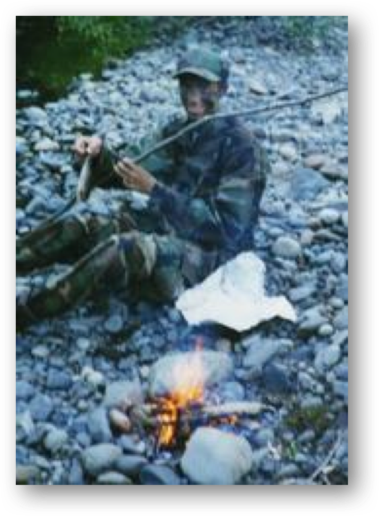 Caleb as a kid - no, this isn't normal fishing gear.  This was a day gone bad bow-hunting with no food, but made better thanks to a fly, 6 feet of leader, and a stick.  One minnow later and nobody died of hunger.