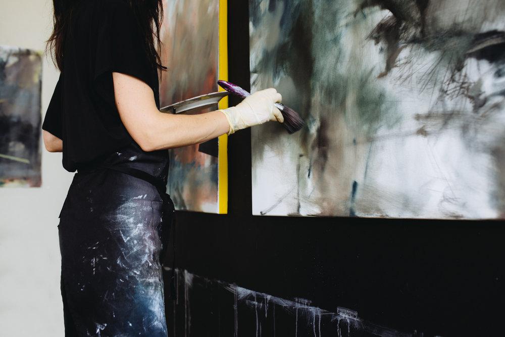 Amanda Watson painting in her studio