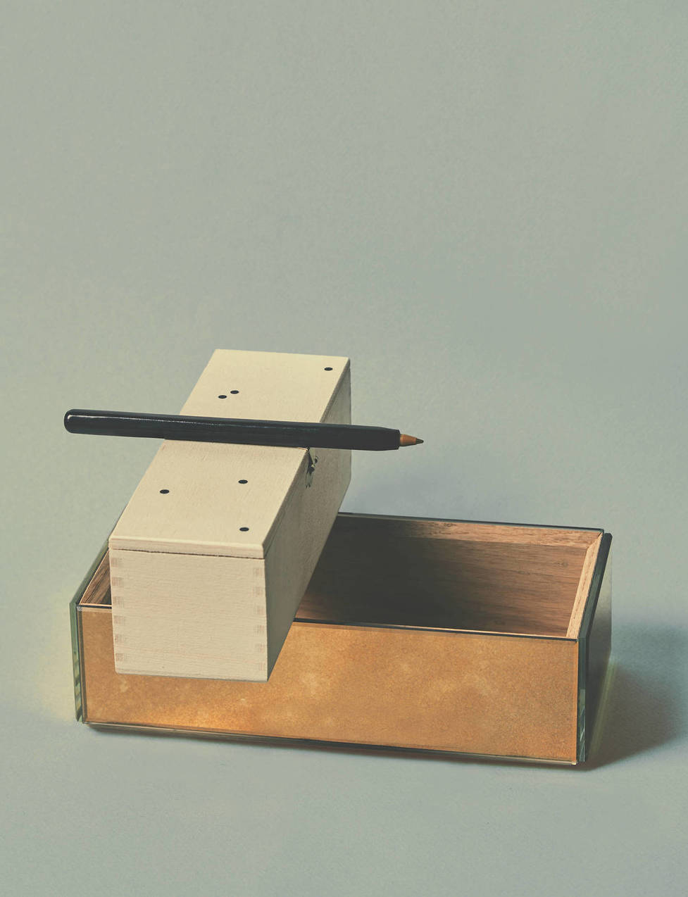 """You can't possibly note all the rhetorical information embedded in a particular arrangement; it is virtually limitless,"" writes Koren. ""But you can try. The more variety, subtlety, and complexity you unearth, the better."" Pictured:   Il Bussetto Pen Cover  ,  Sigmar Italic Pepper Mill by Michael Anastassiades   (in wooden presentation box),   Antique Mirror Container 9"
