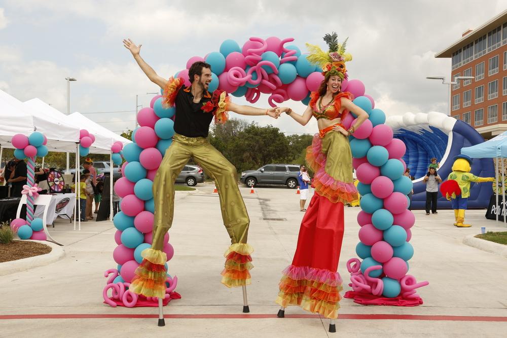 tropical carmin miranda stilt walkers for hire