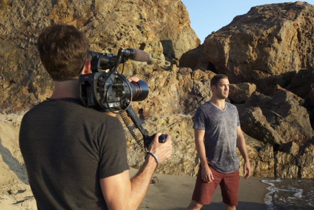 """Lewis Howes being filmed by Jefe Greenheart on Zuma Beach for """"The School of Greatness"""" book trailer."""