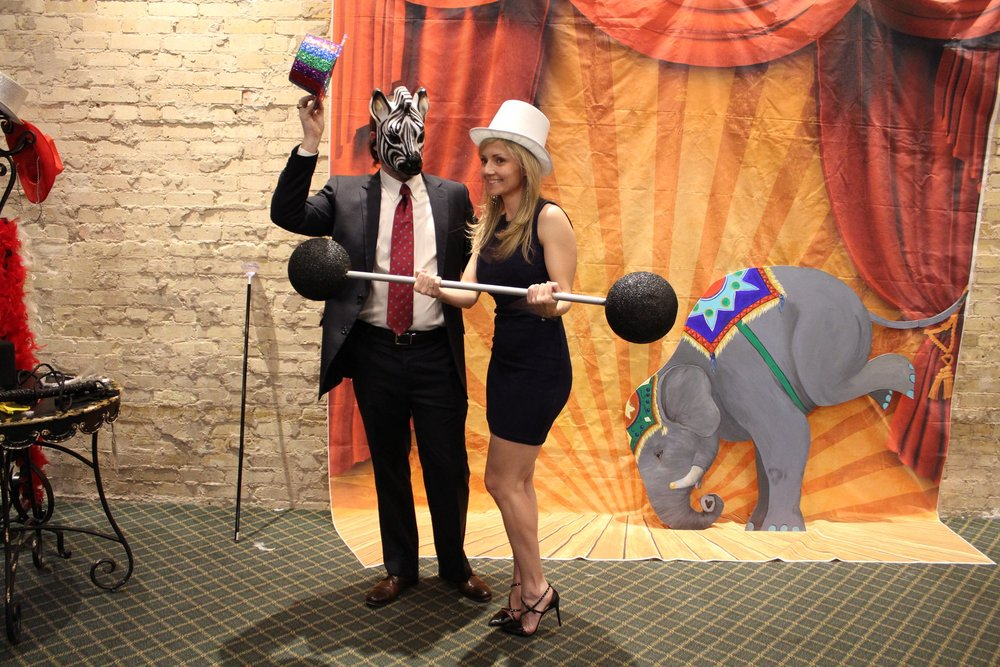 Circus Props and Photo booths are perfect for an interactive corner. Photo cred: www.soliveinc.org