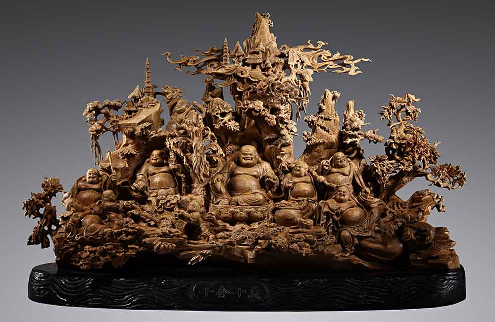 """Perfection"" carved in agarwood.  Various forms of aromatic woods were burned as sacred incense throughout east Asia. In particular, sandalwood and agarwood developed a legendary reputation. Agarwood, aloeswood, or ""oud"" remains among the world's most coveted fragrant materials and is equally if not more expensive than gold."