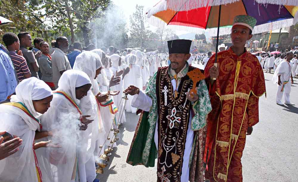An Ethiopian orthodox priest blesses the faithful with incense during Ethiopia's Timket celebration to commemorate the baptism of Jesus Christ by John the Baptist