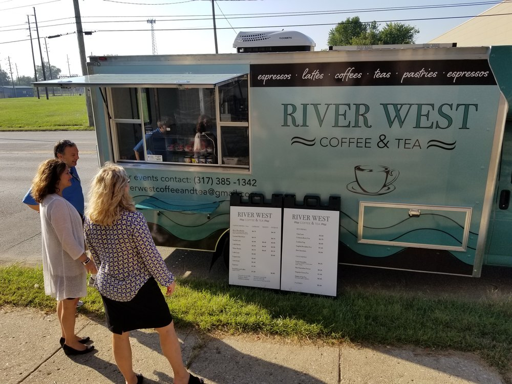 River West Coffee & Tea Owner, Bogdan Zgirta, talks with Near West customers.