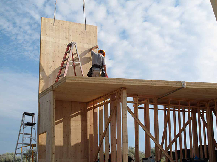 CLT construction needs a considerably smaller crew to construct CLT framing. Retrieved from: inhabitat.com/jesse-garlicks-sky-house-is-an-off-the-grid-vacation-retreat-in-washington/sky-house-washington-lead/