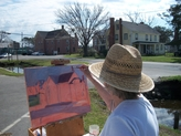 March 17, 2012 - China Grove artist Dianne Overcash took advantage of ideal weather to do some plein air painting during the Art Forum.  Appropriately, she was inspired by the architecture of the historic building, which the Friends are hoping to turn into an art space.