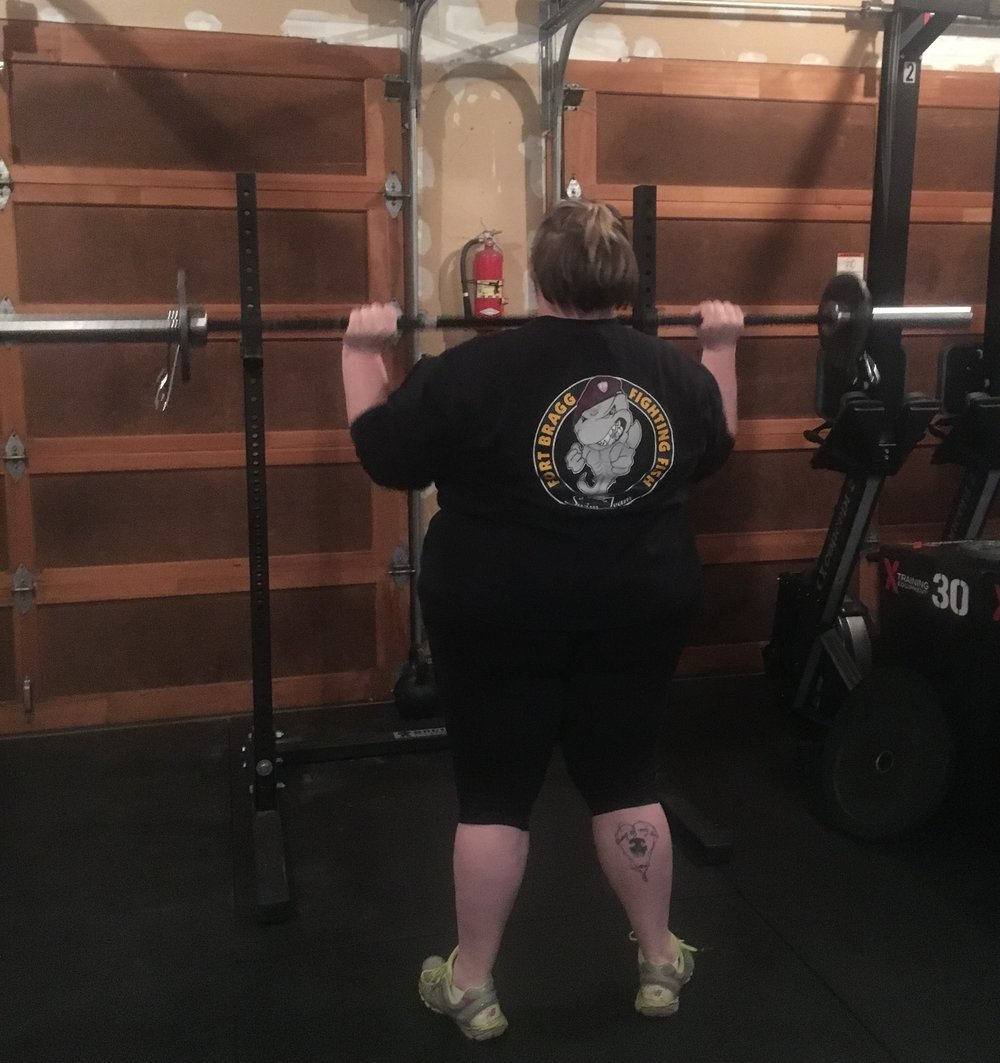 Megan working on her shoulder press