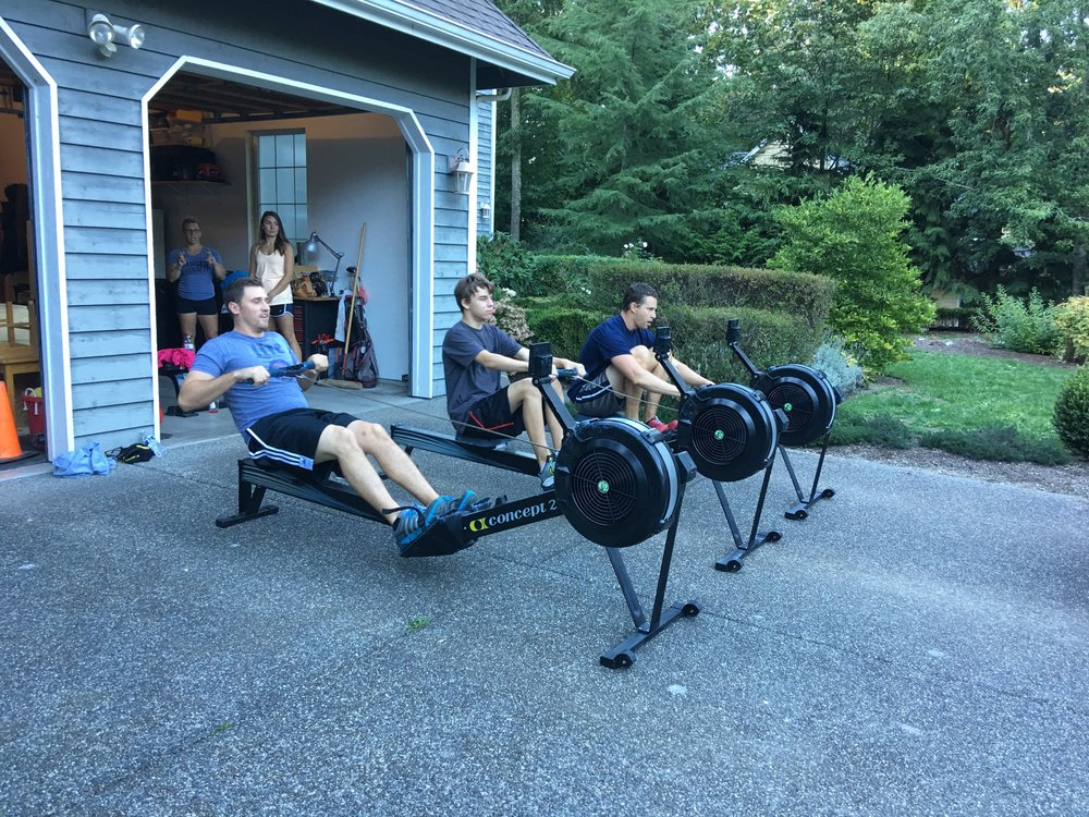 Kyle, Elijah, and Brandon doing 500m row repeats