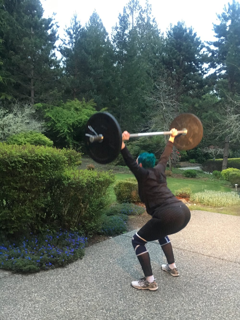 "Maggie powering through overhead squats in ""Nancy"""