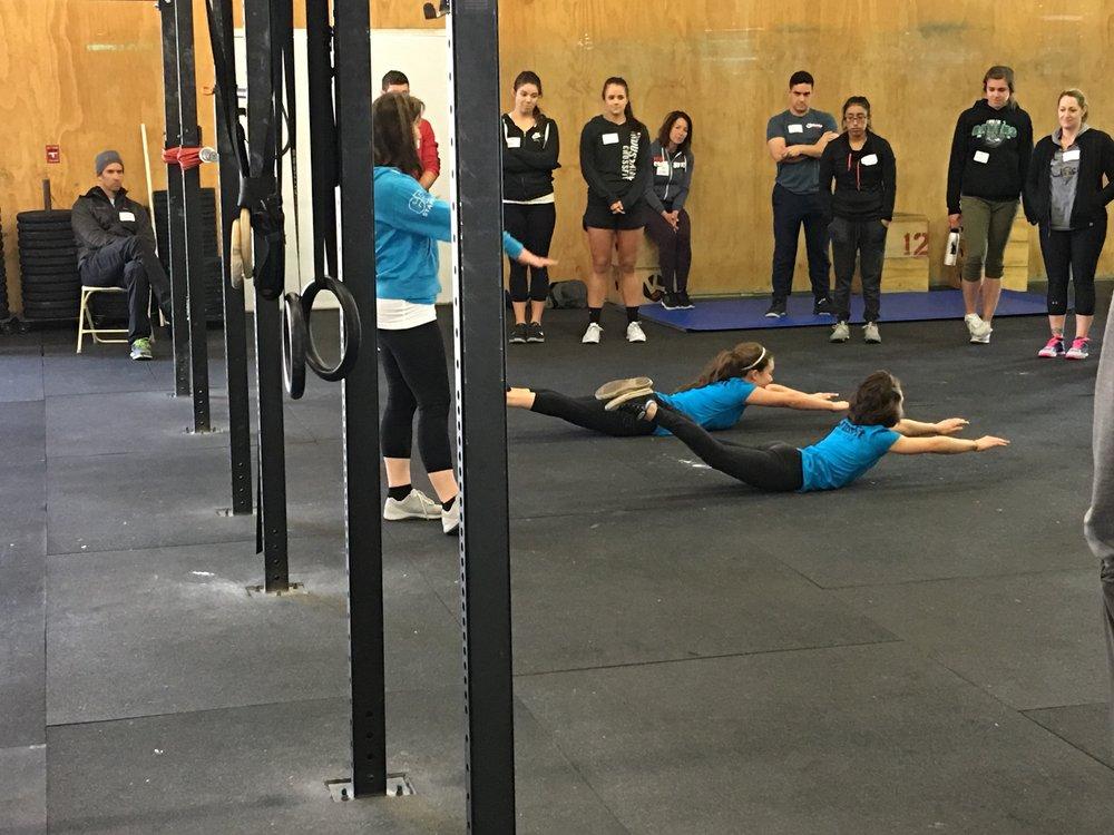 CrossFit Teens demonstrating solid superman holds