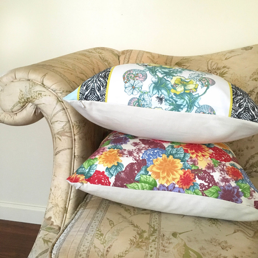Unique Celandine Pillow stacked with colorful Zale Pillow on edge of couch