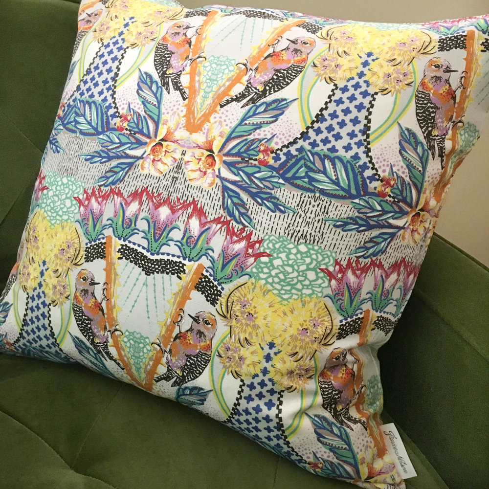 Unique and colorful 20x20 Aves pillow is a tropically-inspired design with cobalt blue leaves and detailed birds