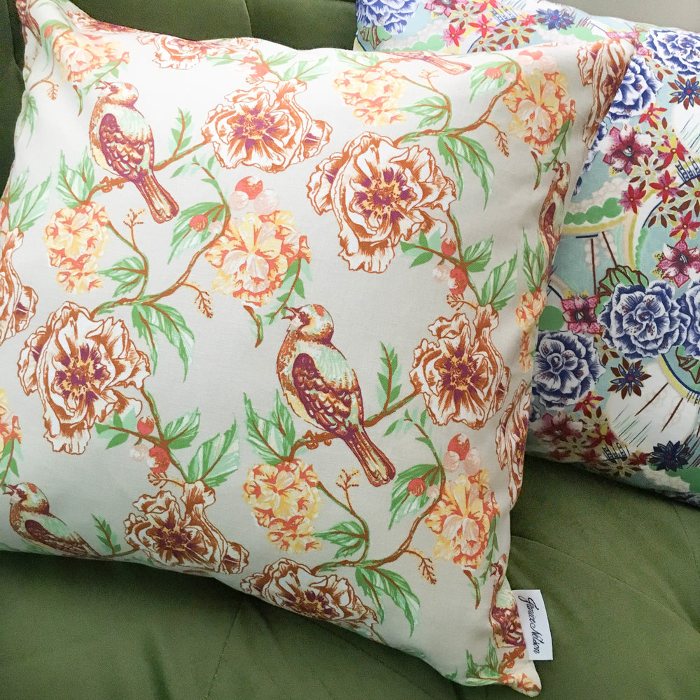 20x20 Aegitha pillow is a classic and timeless design with a colorful, modern twist with yellow flowers and meandering branches with birds