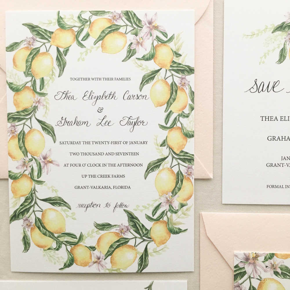 The 'Citrus Wreath Suite' is a bright, lemon yellow citrus wreath design that is classic yet modern. Hand-painted lemons dance around a luxurious cotton paper invitation.