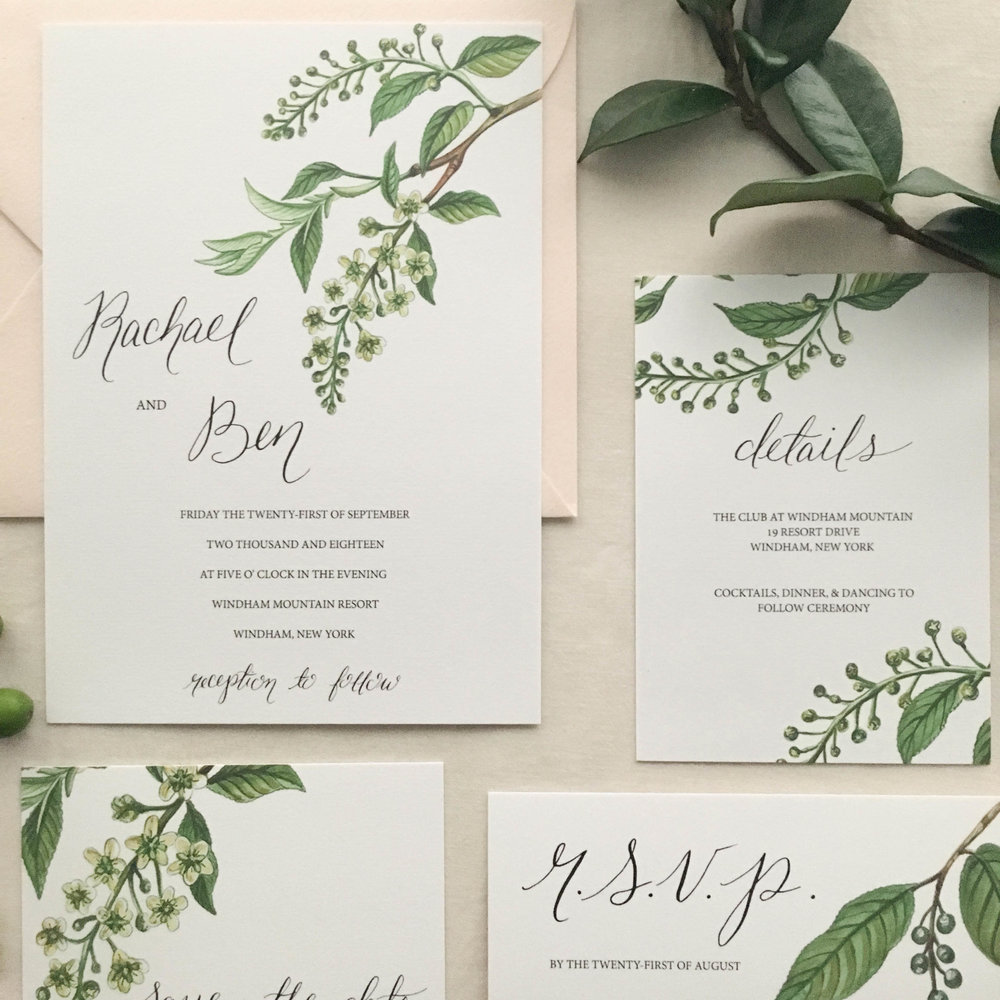 Janice Nelson Made in USA green branch simple wedding stationery with green leaves and cream blossoms, semi-custom hand painted watercolor main wedding invitation custom wedding invite