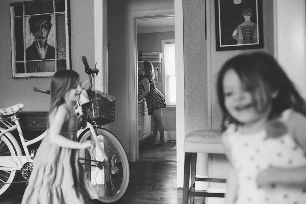 Two girls running in circles.
