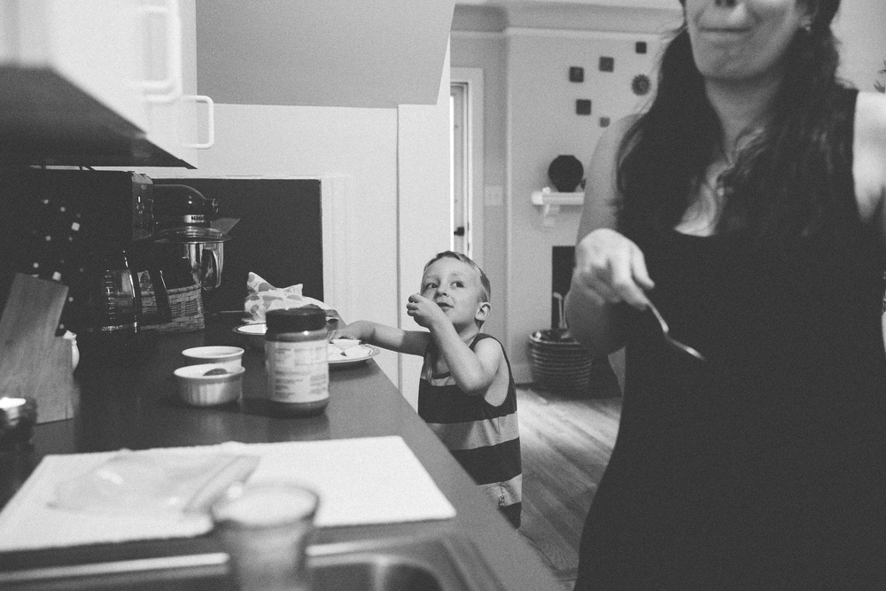 Mom and boy making lunch.