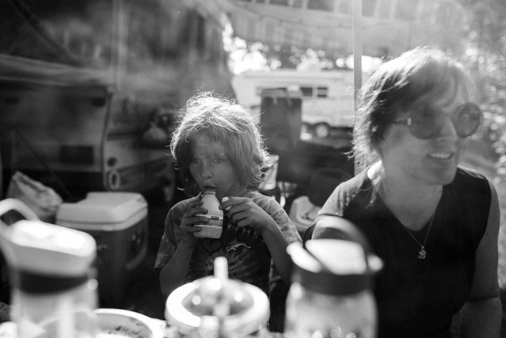 Little boy drinking soda.