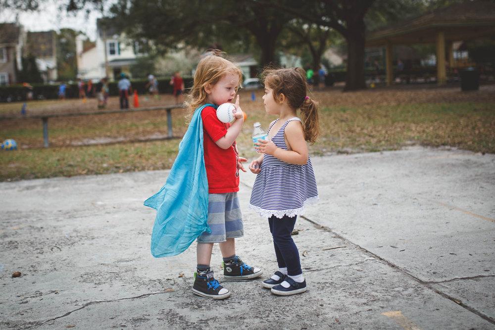 Kids having a conversation on playground.