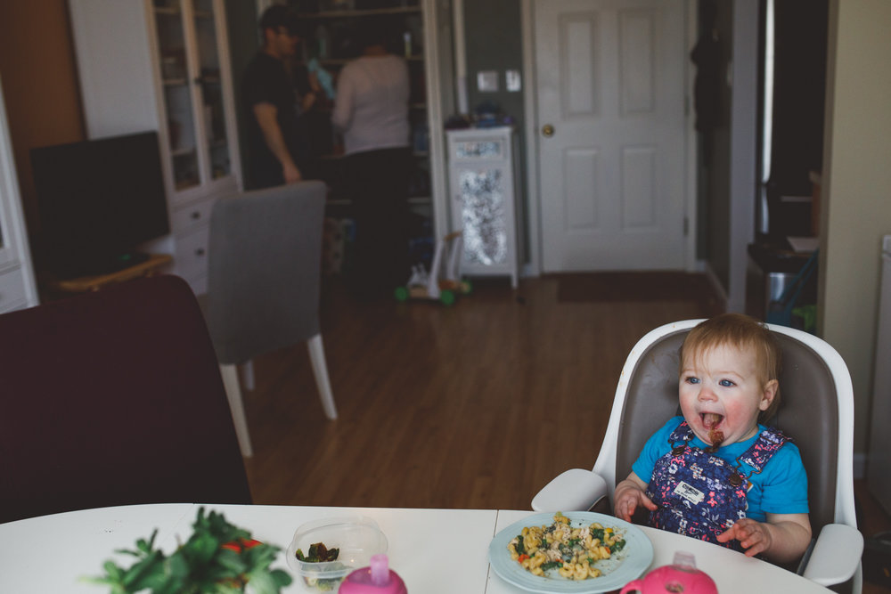 Baby spitting out food.