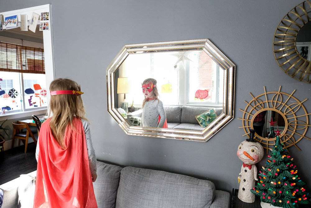 Boy staring at himself in costume.