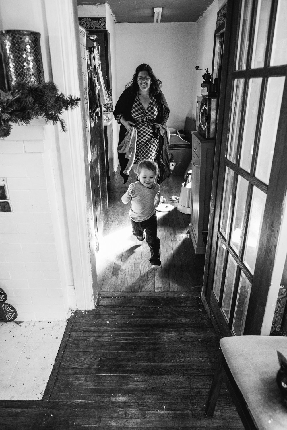 Little girl running from mom.