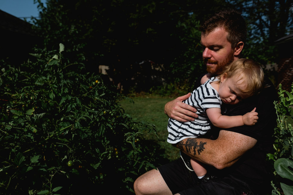 Hugging in the garden. Detroit Family Photographer.